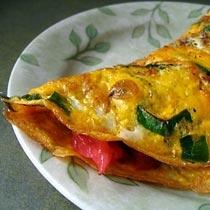 receta gatimi per pegaditjen e omeletes me domate